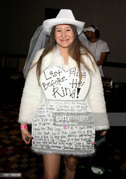 An attendee wears a sign of a list of things to do before getting married during the 2020 AVN Adult Expo at the Hard Rock Hotel Casino on January 24...