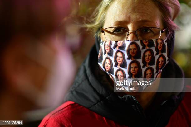 An attendee wears a themed mask before Democratic vice presidential nominee Sen. Kamala Harris speaks at a drive-in election eve rally on November 2,...