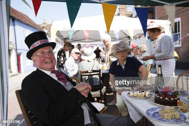 An attendee wears a top hat decorated with Union flags also known as Union Jacks during a street party to celebrate the wedding of Britain's Prince...