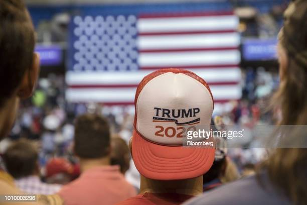 An attendee wears a Trump 2020 hat before the start of a rally with US President Donald Trump in WilkesBarre Pennsylvania US on Thursday Aug 2 2018...