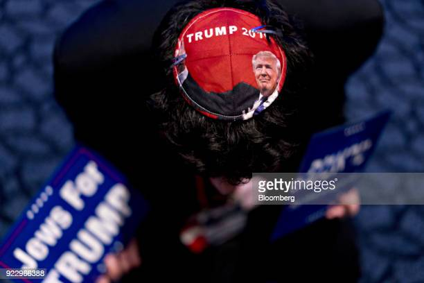 An attendee wears a US President Donald Trump yarmulke at the Conservative Political Action Conference in National Harbor Maryland US on Thursday Feb...