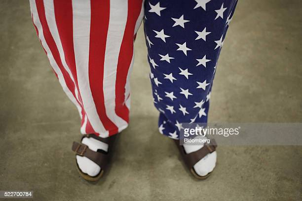 An attendee wears American flag themed pants during a campaign event for Donald Trump president and chief executive of Trump Organization Inc and...