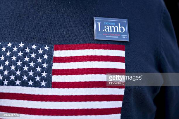 An attendee wears an American flag themed sweater with a Conor Lamb Democratic candidate for the US House of Representatives campaign button before a...