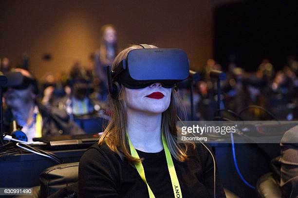 An attendee wears an Oculus Rift virtual reality headset during the Intel Corp press event at the 2017 Consumer Electronics Show in Las Vegas Nevada...
