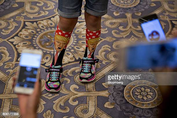 An attendee wears Donald Trump 2016 Republican presidential nominee themed socks while speaking to members of the media during a campaign event at...