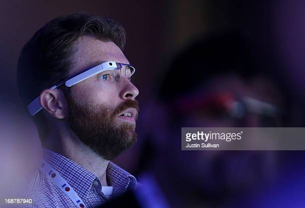 An attendee wears Google Glass as he watches the opening keynote at the Google I/O developers conference at the Moscone Center on May 15 2013 in San...