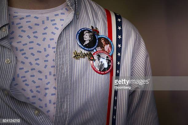 An attendee wears pins while in support of Hillary Clinton former Secretary of State and 2016 Democratic presidential candidate not pictured waiting...