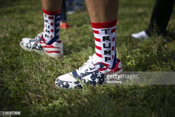 An attendee wears socks that read Trump while standing in line to enter an 'Evangelicals for Trump' Coalition launch event with US President Donald...