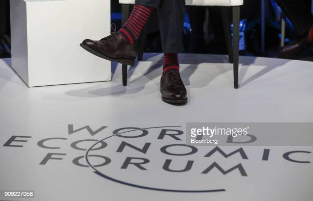 An attendee wears stripey socks on the opening day of the World Economic Forum in Davos Switzerland on Tuesday Jan 23 2018 World leaders influential...