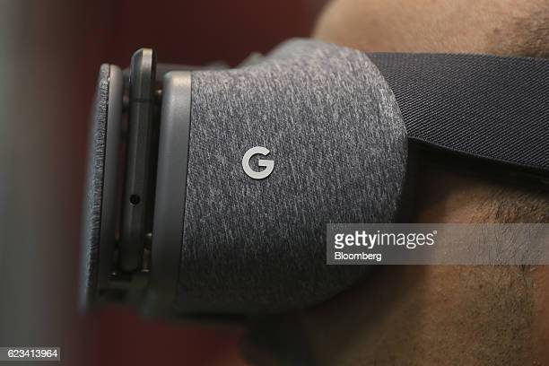 An attendee wears the Google Inc Daydream View virtual reality headset during an event at Google's Kings Cross office in London UK on Tuesday Nov 15...
