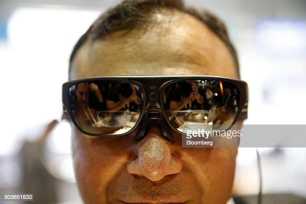 An attendee wears the ODG Ry Smartglasses for a photograph during the 2016 Consumer Electronics Show in Las Vegas Nevada US on Wednesday Jan 6 2016...