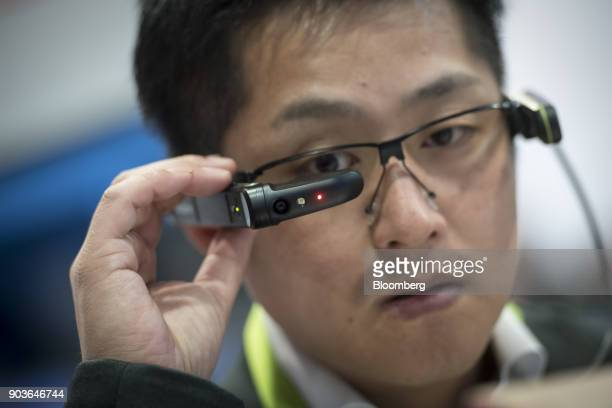 An attendee wears the Vuzix Corp M300 augmented reality Smart Glasses during the 2018 Consumer Electronics Show in Las Vegas Nevada US on Wednesday...