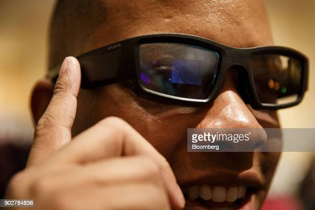 An attendee wears Vuzix Corp Blade augmented reality glasses enabled with Amazoncom Inc Alexa voice assistant during the Pepcom Digital Experience...