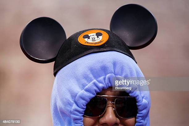 An attendee wears Walt Disney Co's Mickey Mouse ears during the D23 Expo 2015 in Anaheim California US on Friday Aug 14 2015 The D23 Expo 2015...