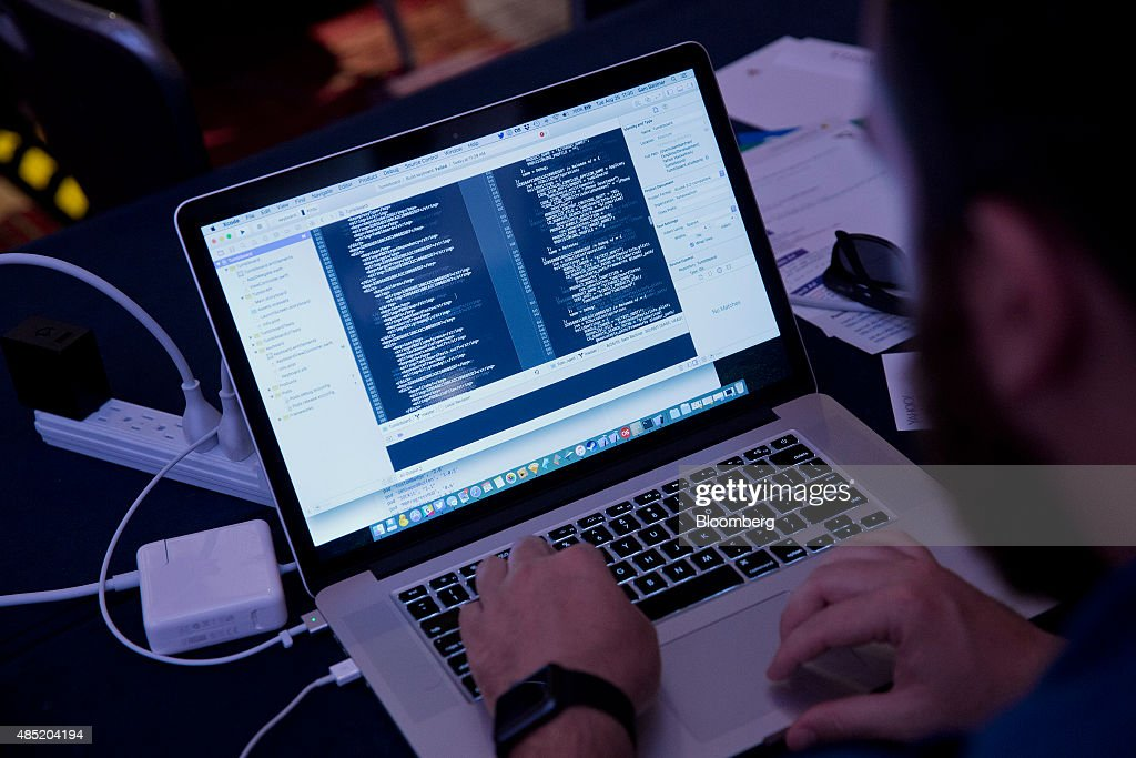 An attendee working on an Apple Inc. laptop computer participates in the Yahoo! Inc. Mobile Developer Conference Hackathon in New York, U.S., on Tuesday, Aug. 25, 2015. The Hackathon is an opportunity for mobile developers to come together and hack around the Yahoo! Inc. Mobile Developer Suite. Photographer: Victor J. Blue/Bloomberg via Getty Images