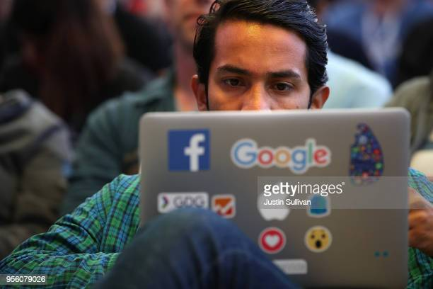 An attendee works on a laptop before the start of the Google I/O 2018 Conference at Shoreline Amphitheater on May 8 2018 in Mountain View California...
