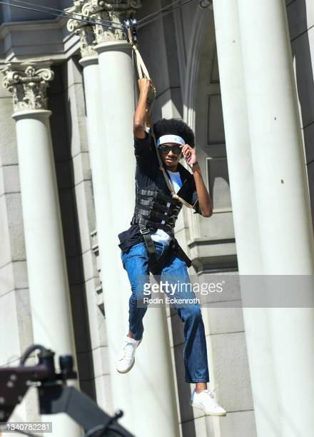 An attendee ziplines at the F9 Fest event on the Universal Studios backlot celebrating F9: The Fast Saga on September 15, 2021 in Universal City,...
