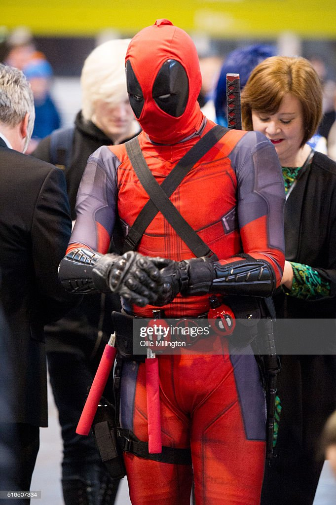 An attendees at Comic Con 2016 in cosplay as a Deadpool on March 19, 2016 in Birmingham, United Kingdom.