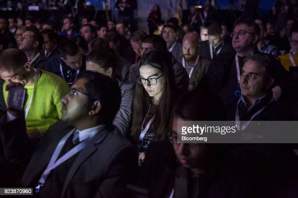 An attendees face is illuminated by a smartphone device during an AlcatelLucent SA launch event ahead of the Mobile World Congress in Barcelona Spain...