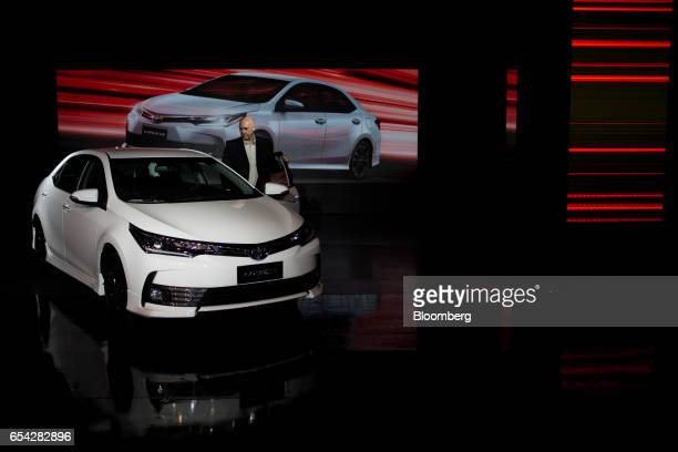 An attendees inspects the new2018 Toyota Motor Corp. Corolla vehicle during the company's launch event in Sao Paulo, Brazil, on Thursday, March 16,...