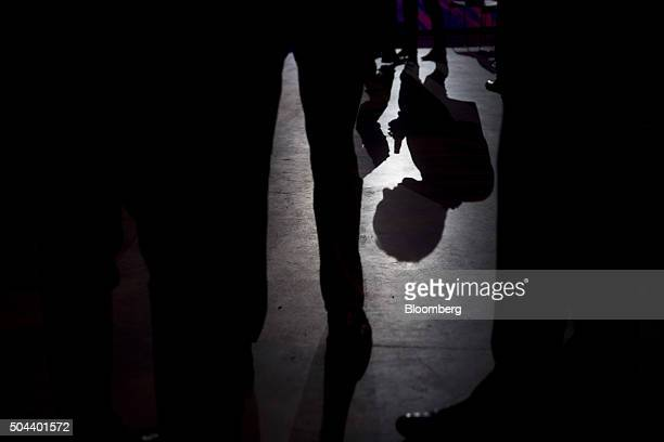 An attendee's shadow is cast on the floor during a General Motors Co Buick event ahead of the 2016 North American Auto Show in Detroit Michigan US on...