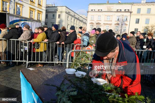 An attendent eats a warm meal as he take part in the 21st Edition of the Biggest Christmas table in Europe at the Main Square in Krakow The so called...