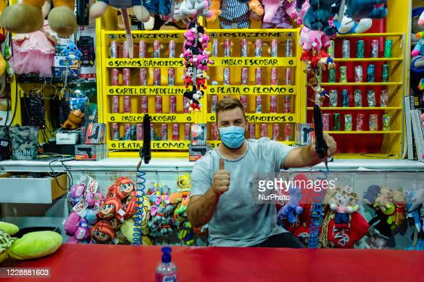 An attraction worker poses for a photo as he waits for customers at Luna Park in Molfetta at Secca dei Pali on October 3 2020 First day of opening of...