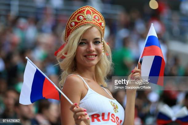 An attractive female Russia fan waves her flags during the 2018 FIFA World Cup Russia Group A match between Russia and Saudi Arabia at the Luzhniki...