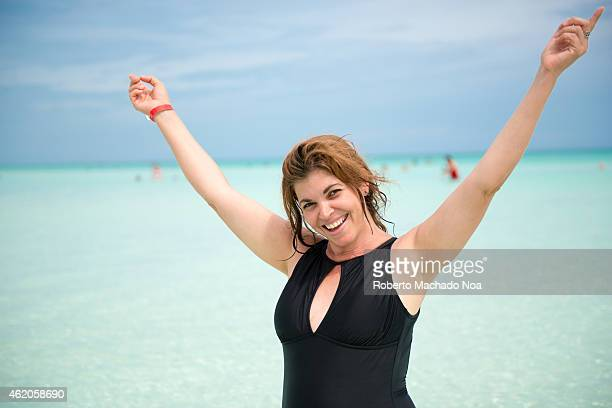 An attractive middle age woman enjoys a tropical beach