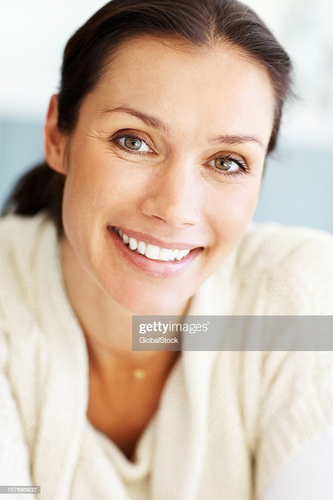 An attractive, middle aged woman giving you a cute smile : Stock Photo