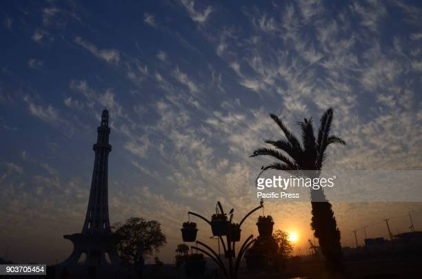 An attractive view of the scattered clouds hovering in the sky over the historical MinarePakistan during a bright sunny day pleasant weather in the...
