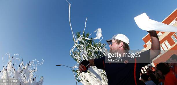 An Auburn fan throws a roll of toilet paper at the Auburn Oaks during the Toomer's Corner Celebration on April 20 2013 in Auburn Alabama