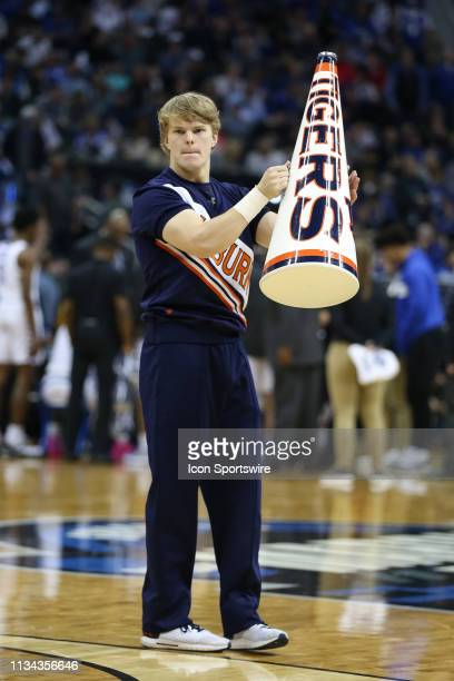 An Auburn Tigers yell leader during a timeout in the second half of the NCAA Midwest Regional Final game between the Auburn Tigers and Kentucky...