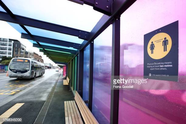 An Auckland Transport bus passes a Karangahape Rd bus stop on August 25, 2020 in Auckland, New Zealand. New Zealanders will have to wear a mask or...