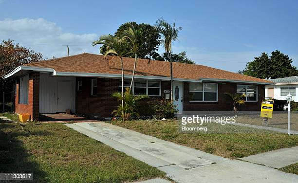 An auction notice is displayed in front of a home for sale in West Palm Beach Florida US on Wednesday March 30 2011 Letting homeowners unload...