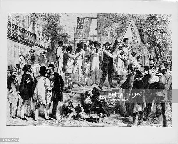A slave auction taking place in the American south circa 1860 Wood engraving from an original sketch by Theodore R Davis Original publication...