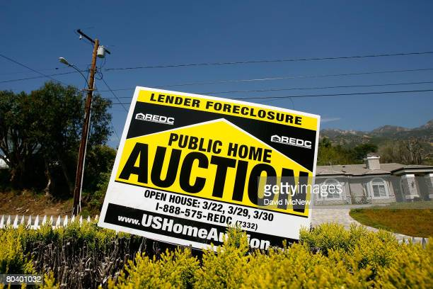 An auction signs stands in the yard of a house to be sold on March 27, 2008 in Altadena, California. Houses are being prepared for an 11-day...