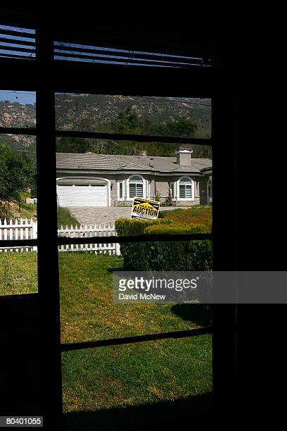 An auction signs stands in the yard of a house to be sold on March 27 2008 in Altadena California Houses are being prepared for an 11day foreclosure...