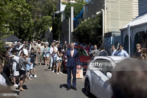 An auctioneer, center, interacts with bidders during an auction of a residential property in the Paddington suburb of Sydney, Australia, on Saturday,...