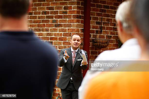 An auctioneer conducts bidding during an auction of a property in the suburb of Roseville in Sydney Australia on Saturday Oct 18 2014 Sydneys median...