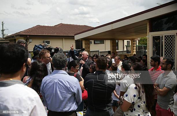 An auctioneer gestures while conducting bidding during the home auction for a fourbedroom house at 230 Blacktown Road on February 14 2015 in...