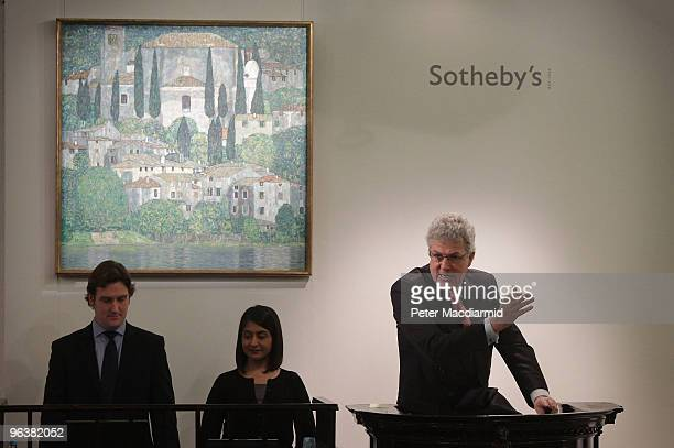 An auctioneer sells Gustav Klimt's 'Kirche in Cassone' for GBP 24 million at Sotheby's on February 3 2010 in London England This work sold during...