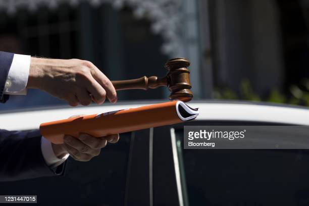 An auctioneer strikes a gavel to mark a sale during an auction of a residential property in the Paddington suburb of Sydney, Australia, on Saturday,...