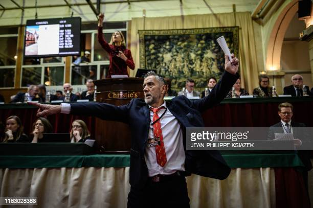 An auctioneer supervises the 159th charity wine auction at the Hospices de Beaune central France on November 17 2019 The Hospices de Beaune charity...