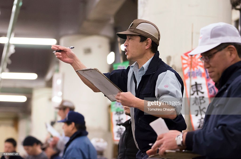 An auctioneer yells out prices during the year's first auction at Tsukiji Market on January 5, 2017 in Tokyo, Japan. Kiyomura Co. bid the highest priced tuna weighing 212 kilogram (467.38 pound) for 74.2 million yen ($637,155) at the year's first auction.