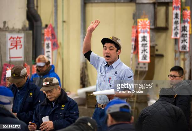 An auctioneer yells out prices during the year's first auction at Tsukiji Market on January 5 2018 in Tokyo Japan Yamayuki Group bid the highest...
