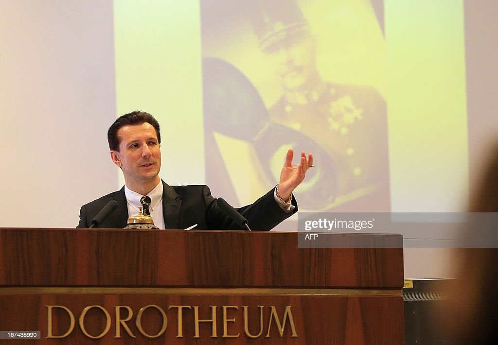 An auctioner gestures during the bid for a lock of hair from Emperor Franz Joseph I of Austria as part of an auction of Imperial Court Memorabilia and Historical Objects at the Palais Dorotheum in Vienna on April 25, 2013. The lock of hair was sold for 11,000Euros.