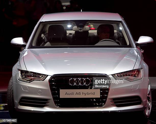 An Audi AG A6 Hybrid sedan sits on stage following its unveiling at the North American International Auto Show in Detroit Michigan US on Monday Jan...