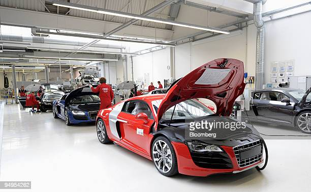 An Audi AG employee performs a final check on an Audi R8 automobile on the assembly line at the company's factory in Neckarsulm Germany on Wednesday...