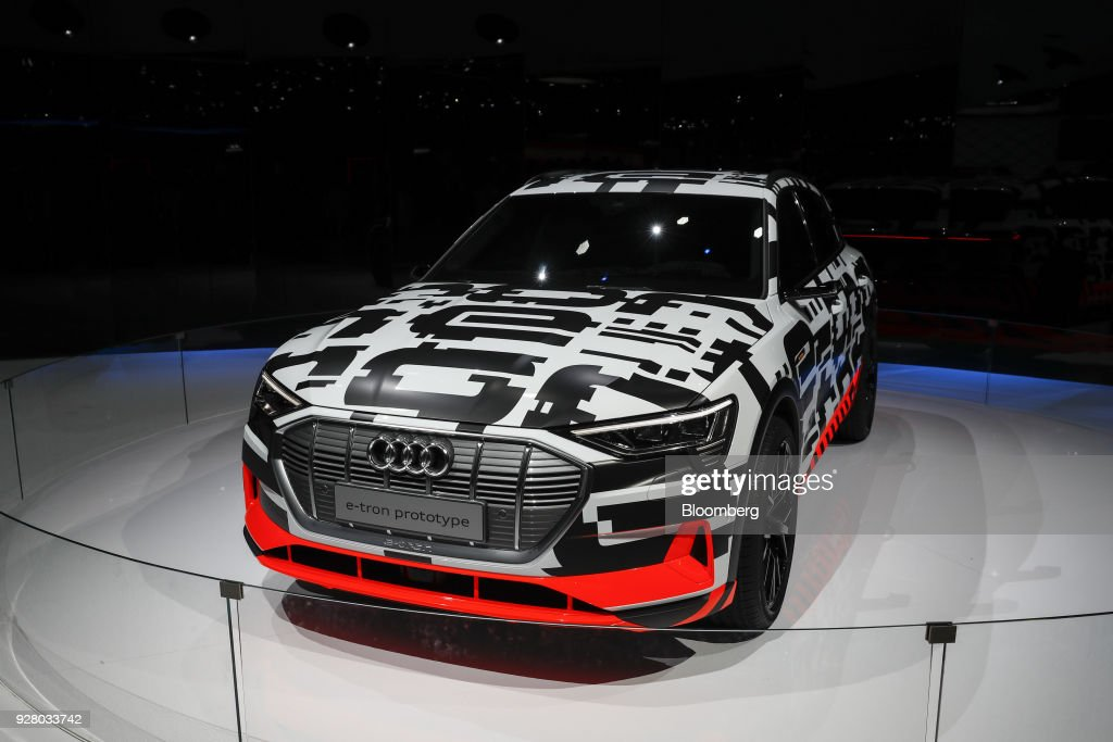 An Audi AG e-tron prototype electric automobile sits on the display on the opening day of the 88th Geneva International Motor Show in Geneva, Switzerland, on Tuesday, March 6, 2018. The show opens to the public on March 8, and will showcase the latest models from the world's top automakers. Photographer: Stefan Wermuth/Bloomberg via Getty Images